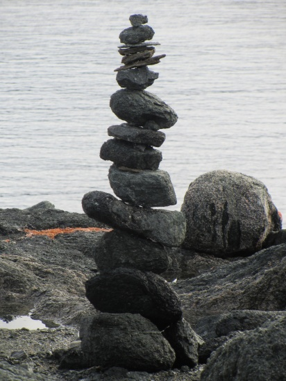 Tall inuksuk on east Qaummaarviit island